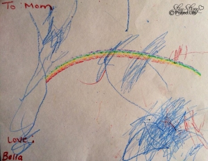 Bella drew this at daycare weeks prior to her departure. She made the rainbow with a special crayon, which is incredible considering at 18 month old all she was capable of was scribbling. The scribble on the side looks like an angel.